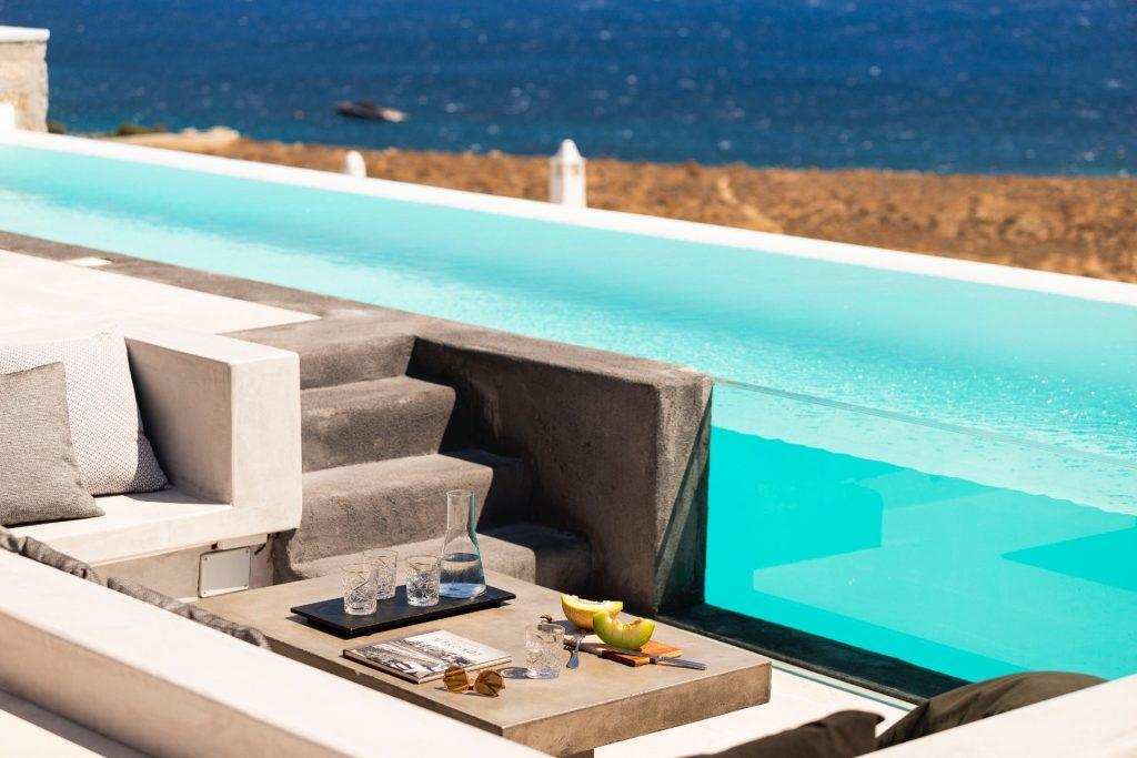 outdoor area with pool and stunning view