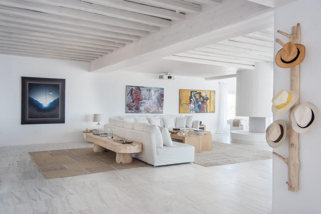 spacious living room in white tone with wooden details
