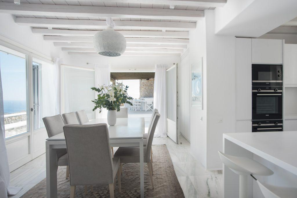 elegant dining room with decorative flowers ideal for lunch with friends
