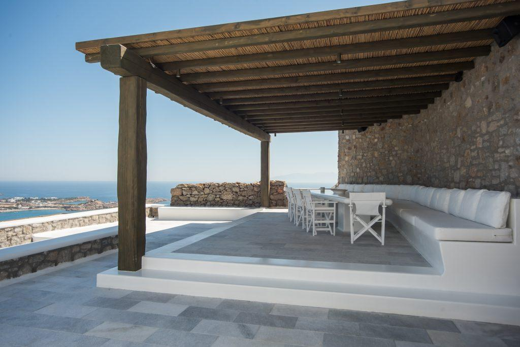 terrace with a wooden canopy that fits perfectly along the stone walls of the villa