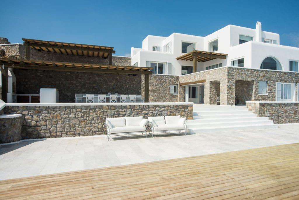 view of a luxury villa with a mixture of white and stone walls