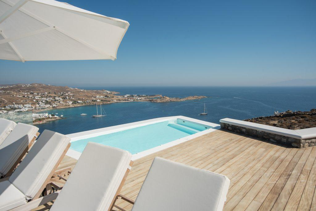 view of the beautiful blue sea and clear sky from the pool of pleasant water