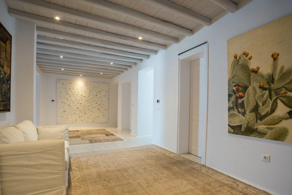 white walls of hallway and a beautiful large picture of a cactus