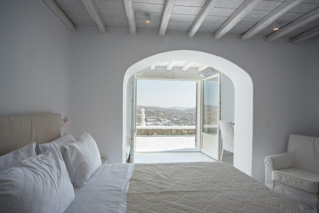 bedroom with a beautiful view and a comfortable bed