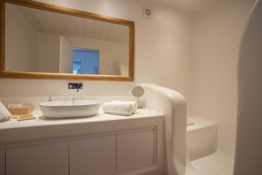 simply designed bathroom with sink and large mirror