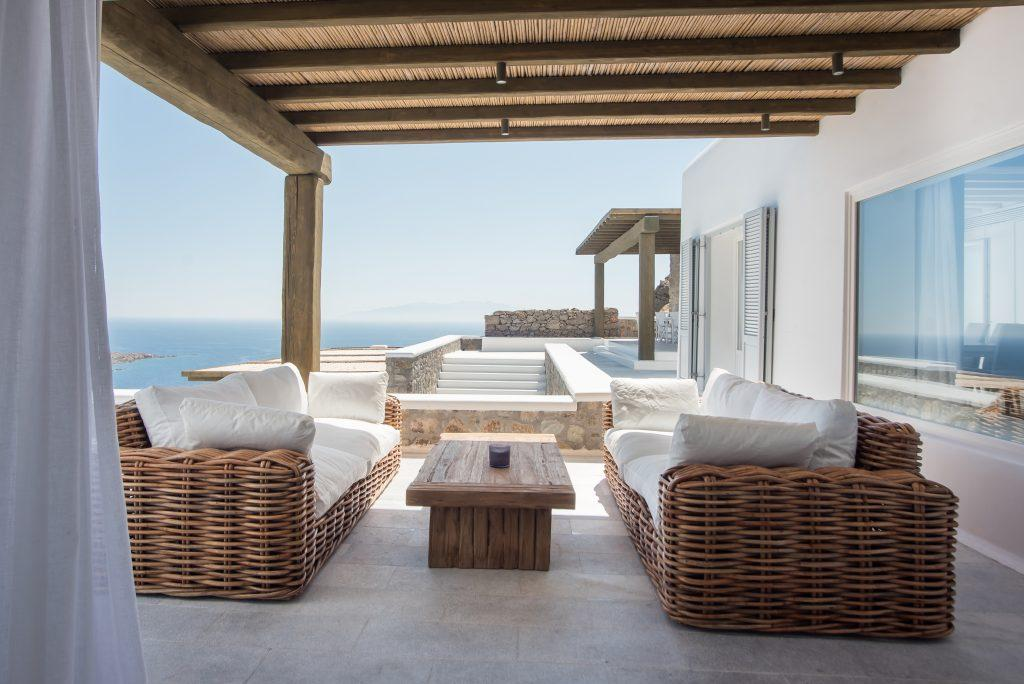 spacious balcony overlooking the endless blue sea is an ideal place to enjoy a quiet summer day