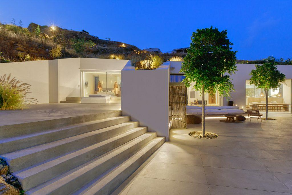 outdoor area with lit villa walls and stairs