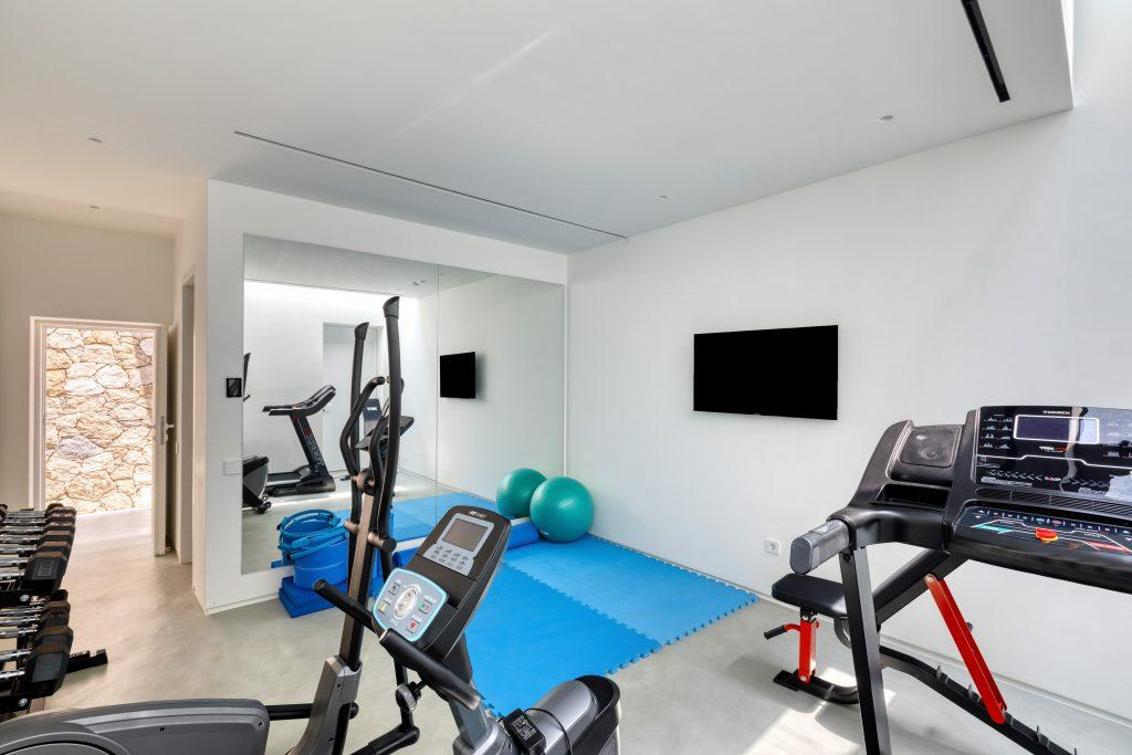 gym with equipment and flat wall tv