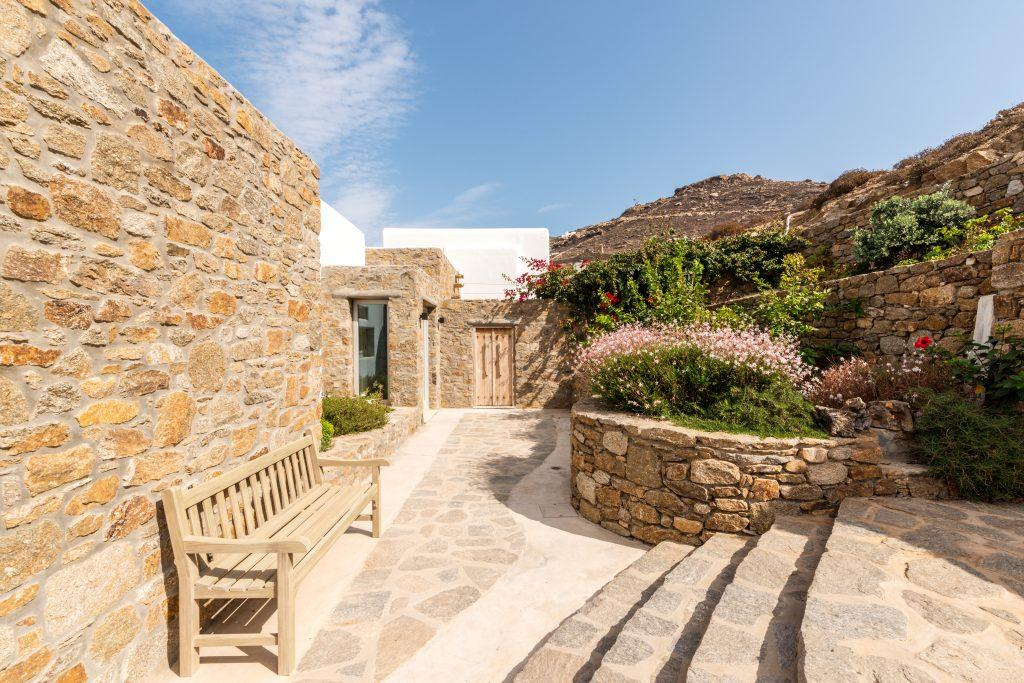 outdoor area with stone walls and greenery with blue sky view