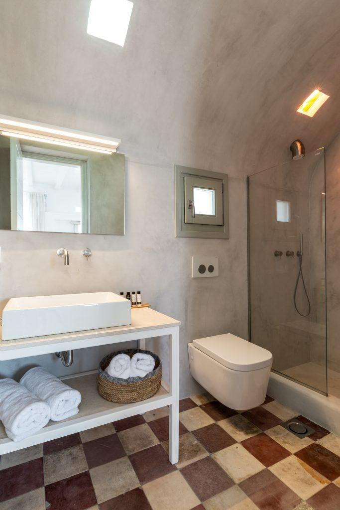 modern designed bathroom for showering and cleaning with grey walls