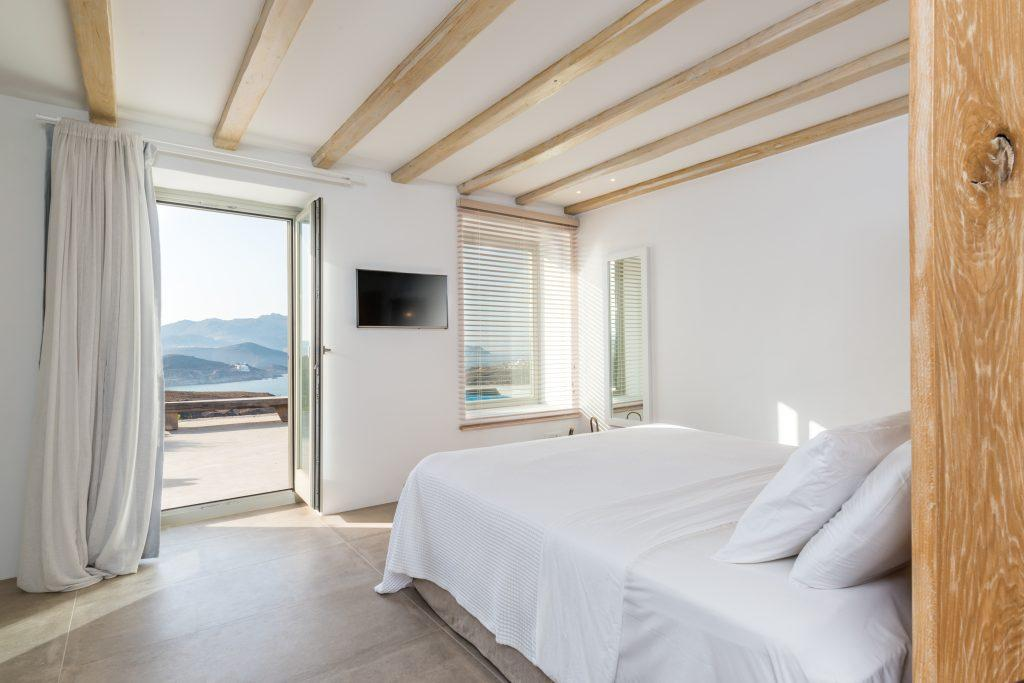white wall bedroom with beautiful sea view