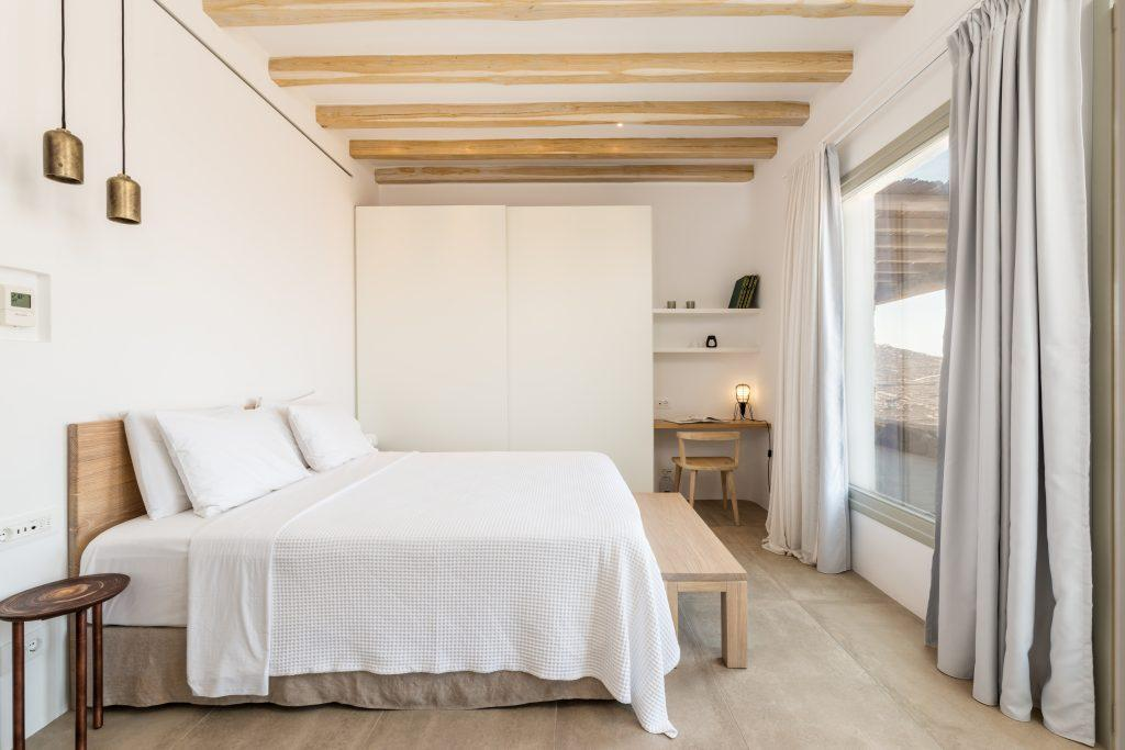 white wall bedroom with bed and night stand