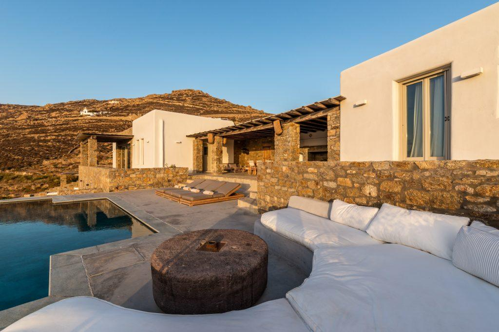 outdoor area for relaxing by the pool with climbers