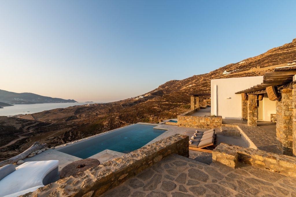outdoor area for relaxing on climbers next to the pool with beautiful view