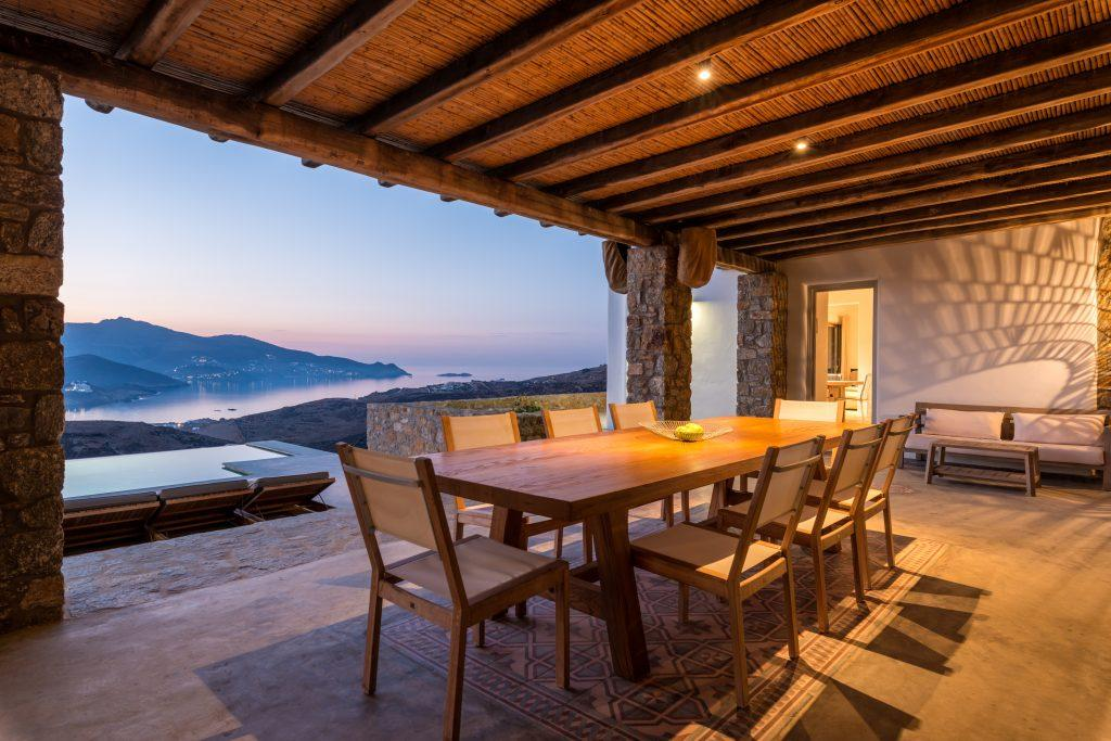 outdoor dining area with wooden chairs for dinner with friends and family