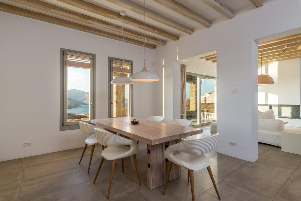 area with dining table and modern chairs to enjoy tasty prepared meals