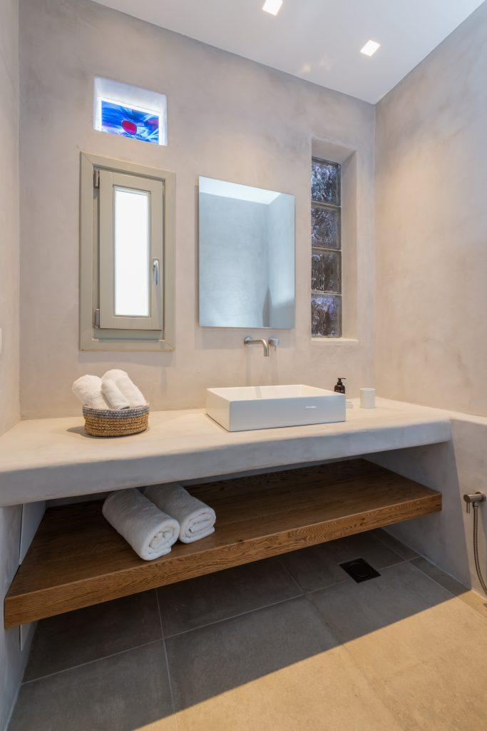 grey wall modern designed bathroom for washing up and cleaning