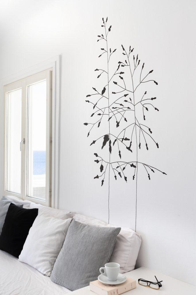 white wall living area with beautiful tree drawing