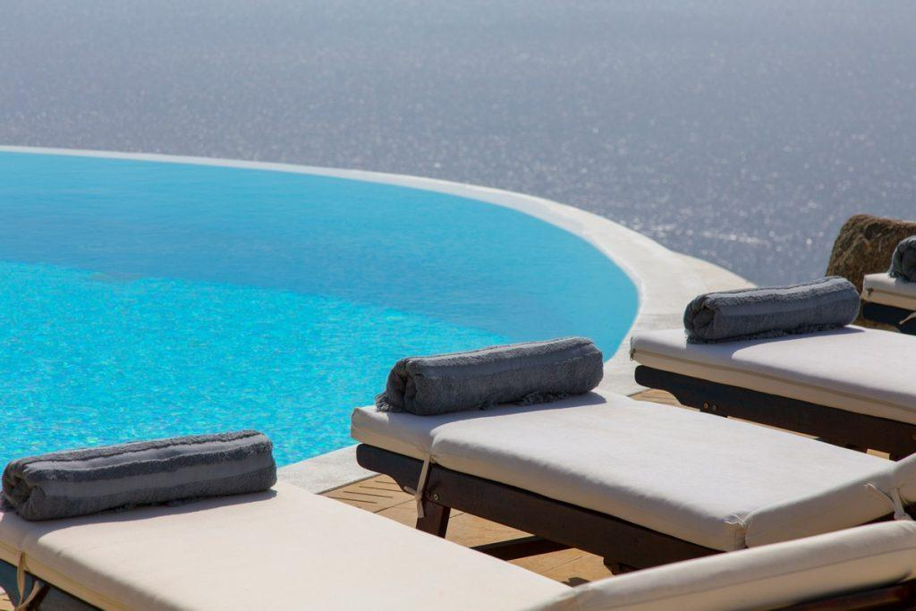 comfortable wooden deck chairs with soft white pillows ideal for sunbathing
