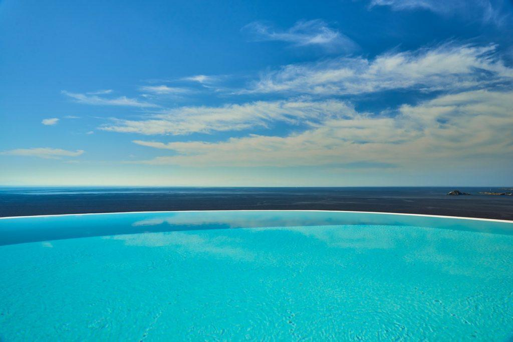 beautiful view of the clear blue sea from the pool of pleasant water