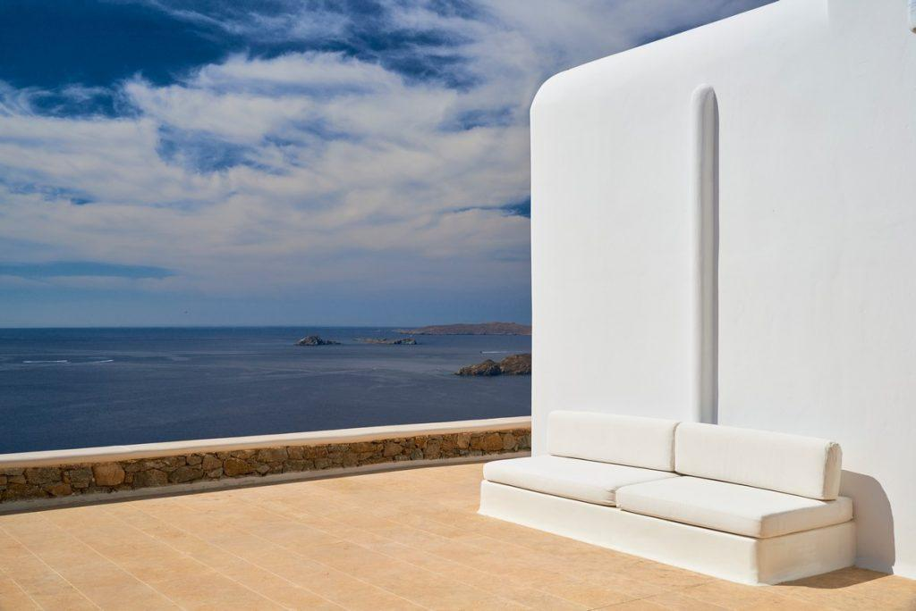 balcony with decorative stones and a view of the calm blue sea