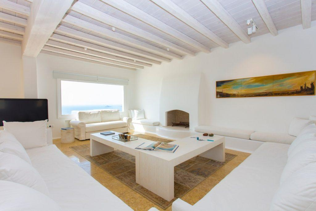 living room with huge furniture and fireplace in white that contribute to the atmosphere