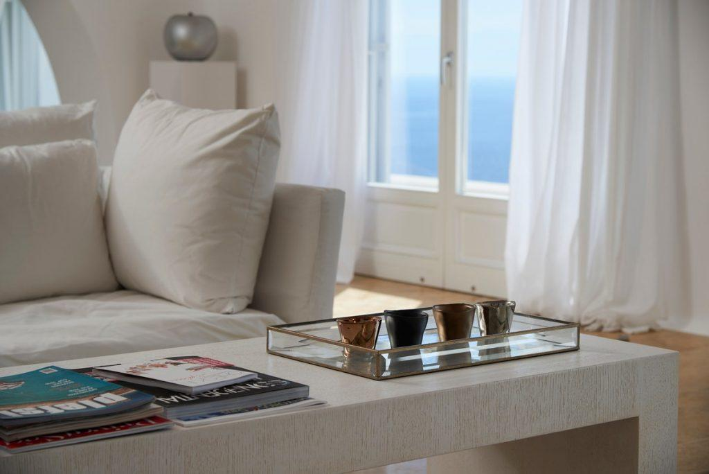 white furniture and a table in the same tone with decorative details
