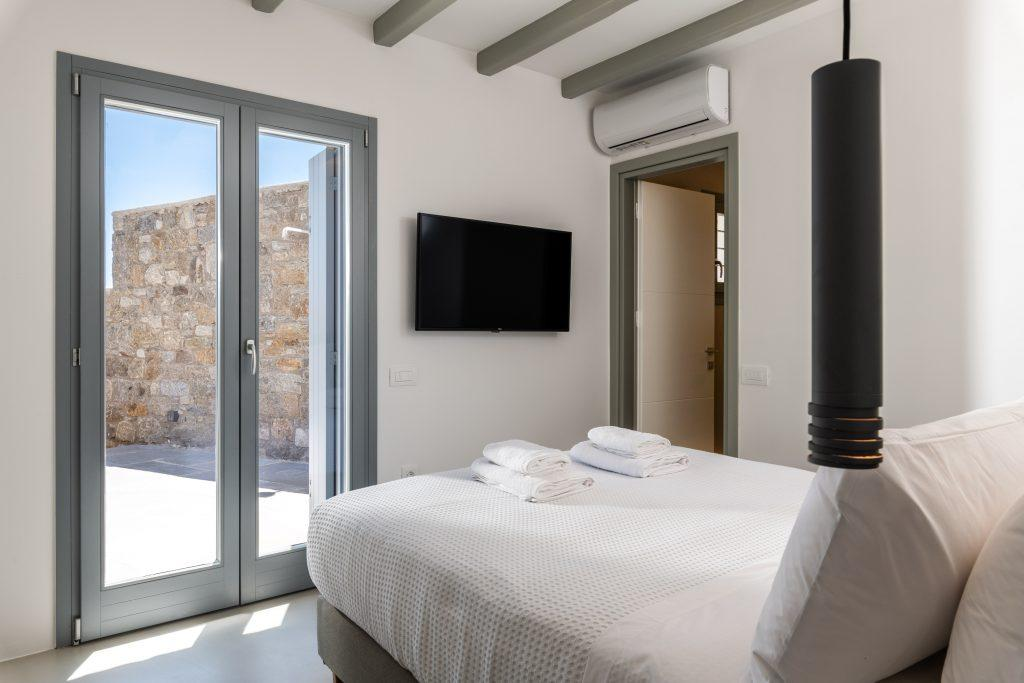 bedroom with cozy king size bed and private terrace
