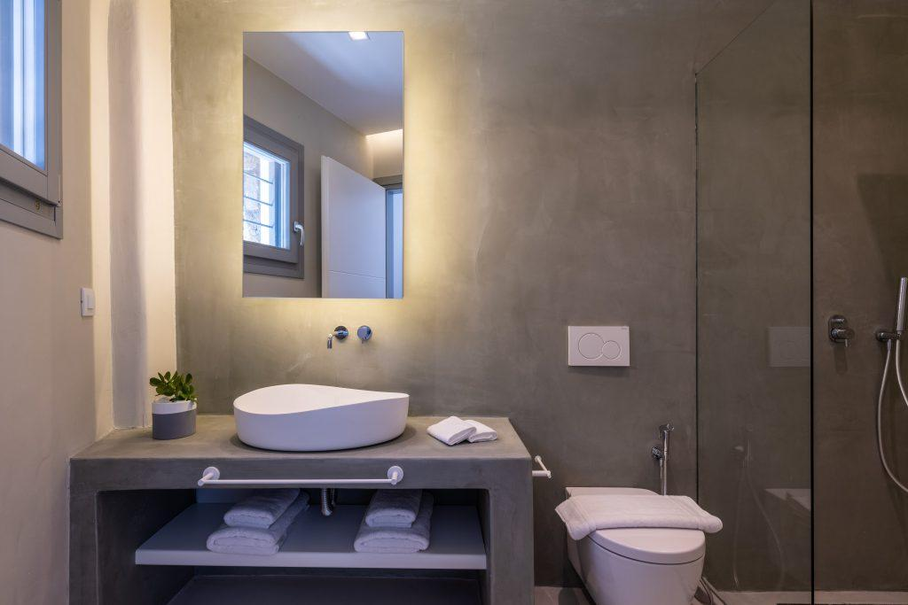 bathroom with gray walls and white sink ideal for bathing