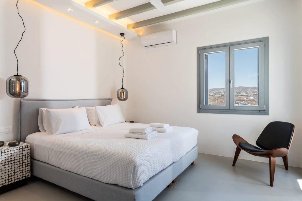 room with white walls and a modernly designed comfortable chair in the corner