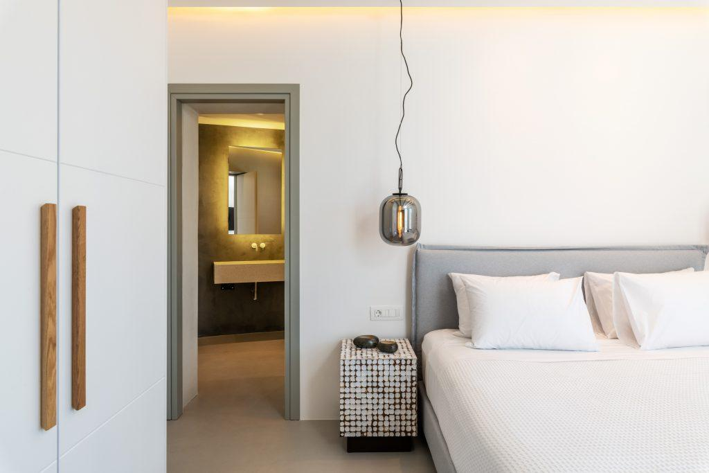 room for two with a comfortable king size bed and a modern nightstand in the corner