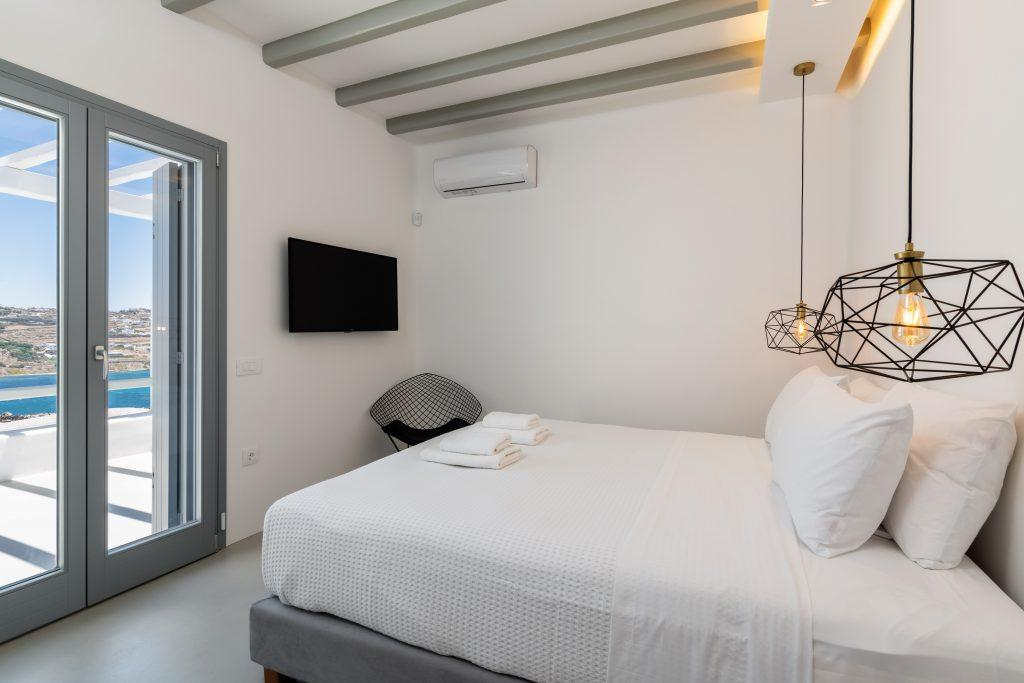 bedroom with white walls and modernly designed black lamps