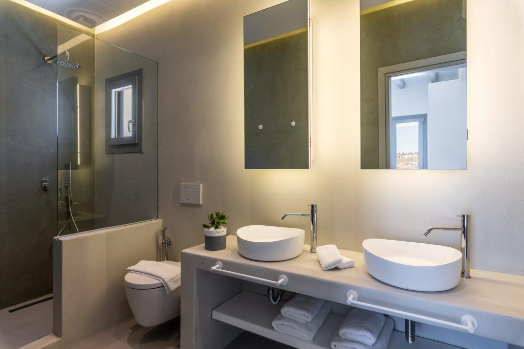 modern bathroom with glass shower and cream walls