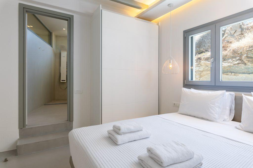 room for two with a comfortable king size bed and a simple chandelier