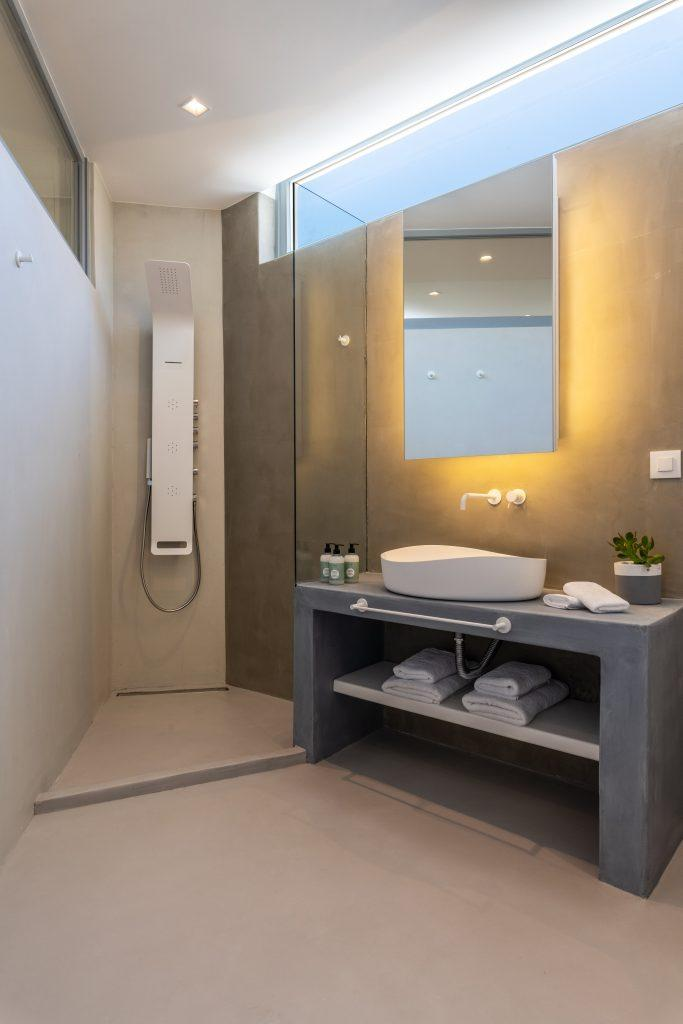 modernly designed bathroom with gray walls and white sink
