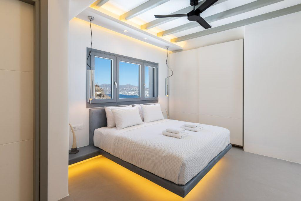 room for two with king size bed lit by dim light