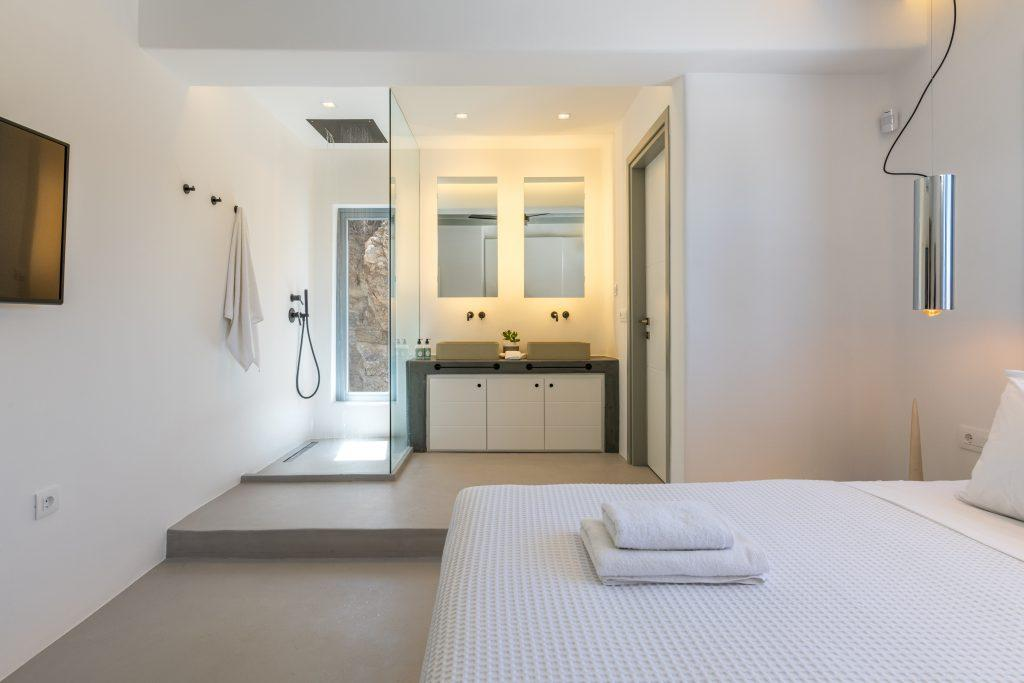 bedroom with glazed shower and dba sink with mirrors ideal for two