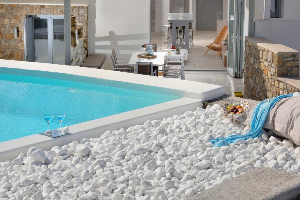 pool with cold water and special details made of white stone