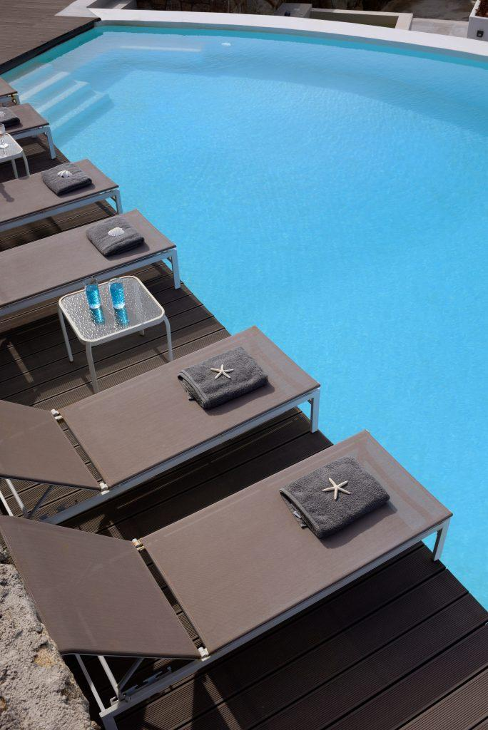 pool with comfortable gray loungers