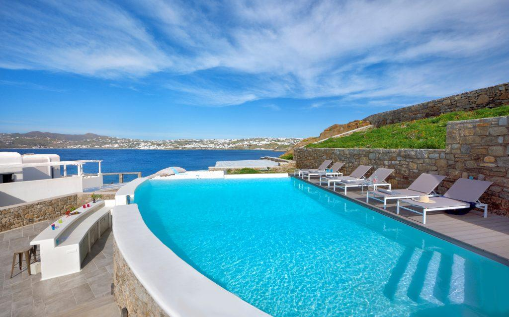 pool overlooking the crystal blue sea and bar