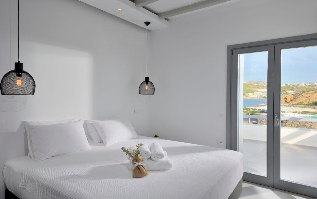 bedroom overlooking the crystal blue sea and terrace