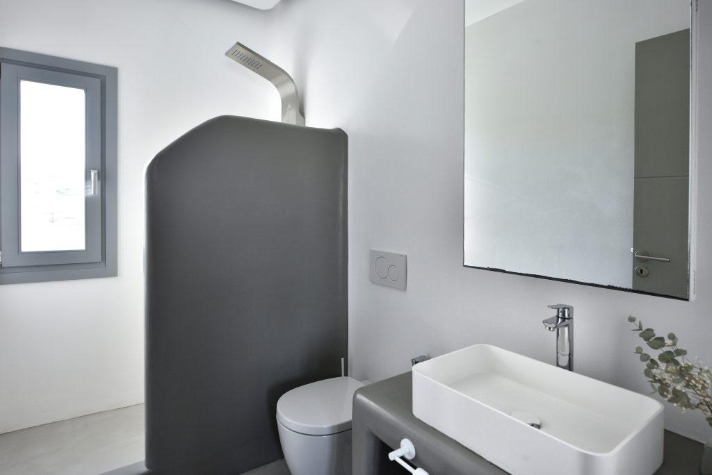 white wall bathroom with large mirror and shower