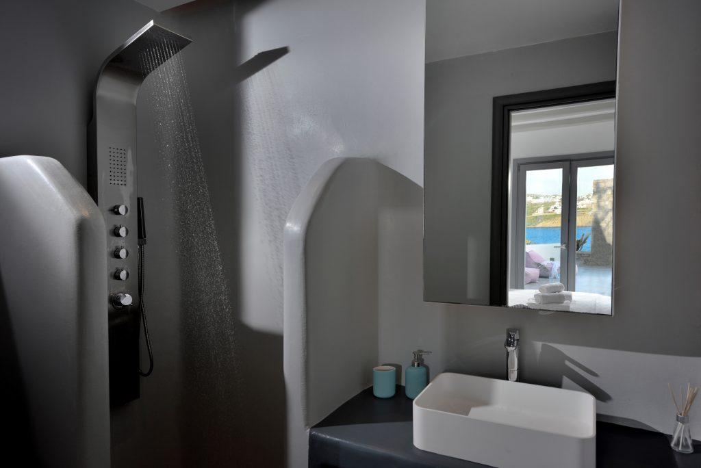 bathroom with white sink and large mirror