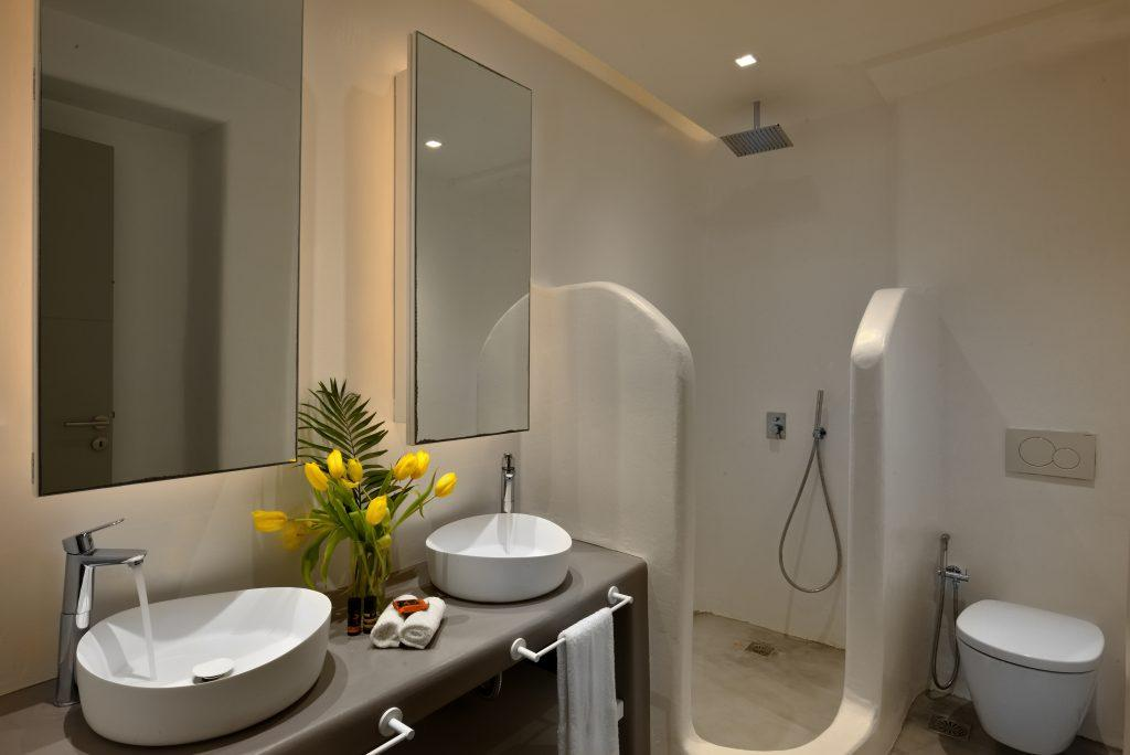 modernly designed bathroom with shower and sink decorated with a yellow bouquet of flowers