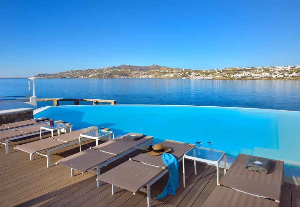 view of the beautiful clear sea and nature from the pool with cooling water