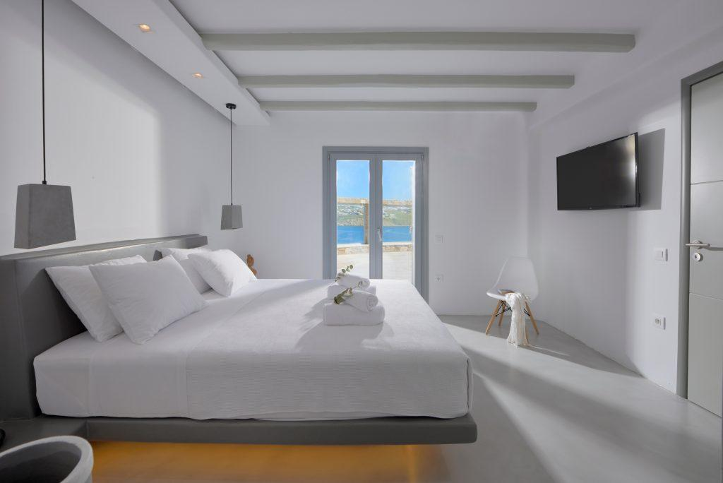 simply designed room with white linens and a comfortable bed