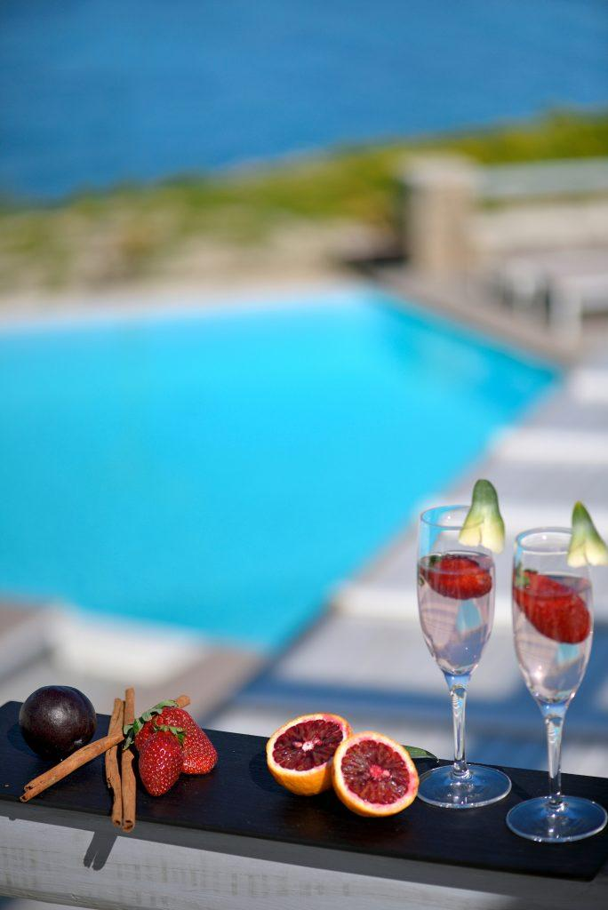 enjoying cocktails and exotic fruits in a luxury villa