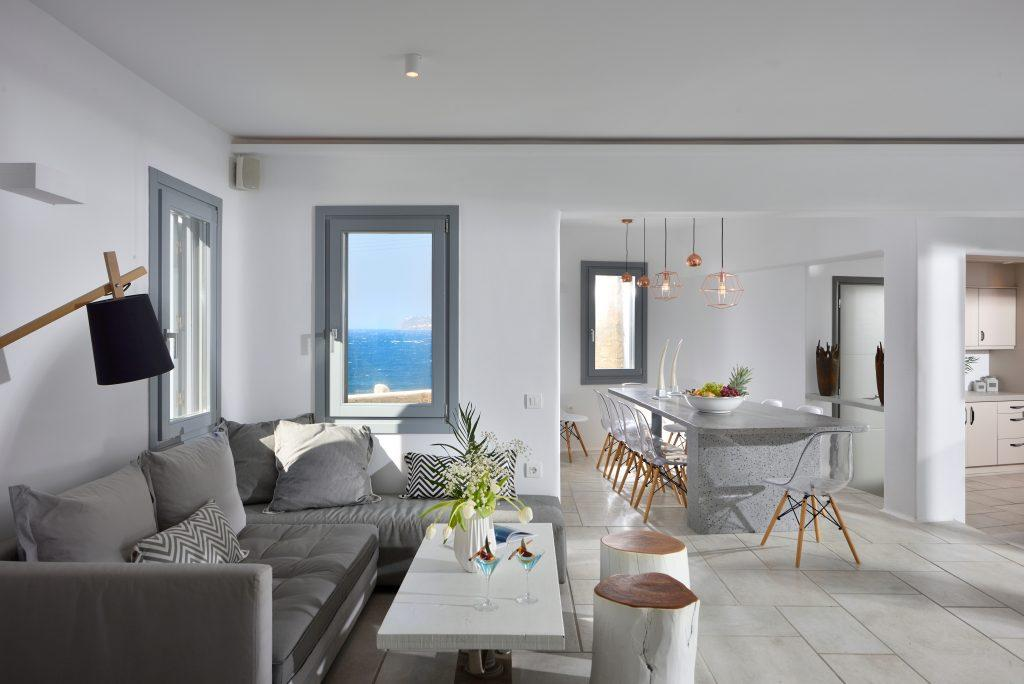 living room with white walls and comfortable gray furniture ideal for relaxation