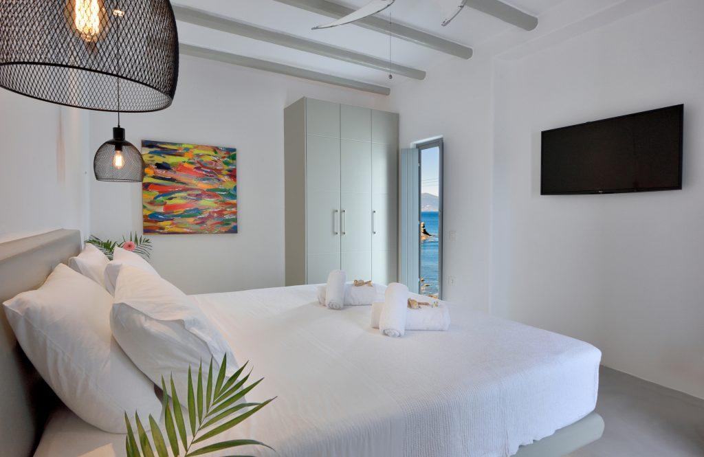 room for two with white walls and a colorful picture as a detail