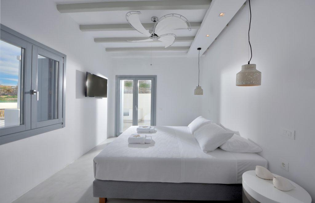bedroom with daylight and cozy king size bed